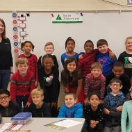 Katherine James of the Lexington office with her 3rd grade Junior Achievement class