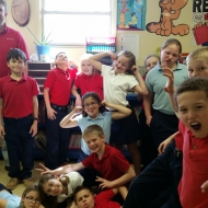 """Garret Arnold spent several weeks volunteering in the 3rd Grade class at Holy Cross School in Ft. Branch, Indiana.  He presented the Junior Achievement unit lessons called """"Our City,"""" teaching the students  about the different aspects of a city and how it operates collectively with people and businesses."""